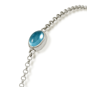 close up of Blue Topaz Cabochon Bracelet - silver - by Scarab Jewellery Studio