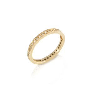 The Odine Full Eternity Ring is handmade in yellow gold and 37 white diamonds