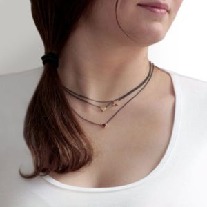 Gold Cross Necklace and Gold Heart Necklace on Model by Scarab Jewellery Studio